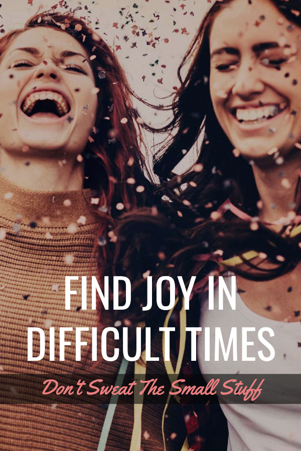 Girls laughing and finding joy in difficlult times