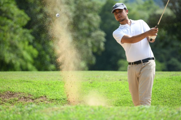 Man intensely focusing on golf