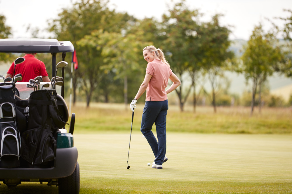 Woman relaxing on golf course